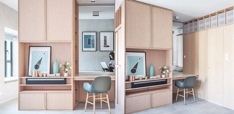 30㎡小住宅,将工作室与住宅融合在一起,巧妙利用橡木橱柜做划分,减少墙面的开阔感!