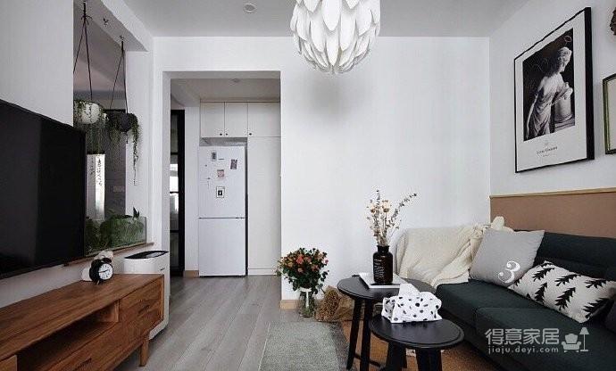 50平小户型装修,餐厅的面积不大,但是布置的很温馨,墨绿色的背景墙奠定了颜值图_3