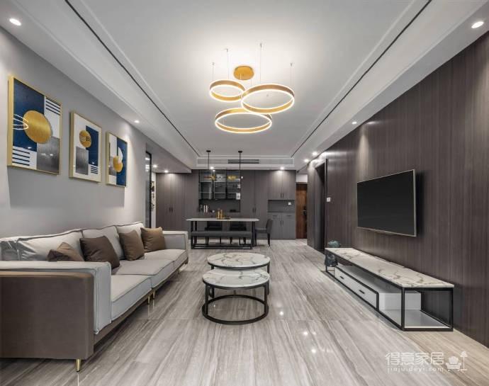 整体以高级灰为主色调,高频次使用金属色来增添轻奢质感,静谧蓝的加入更是注入了一丝优雅气息,再辅以黑色的稳重与白色的大气,整个空间浑然天成的色彩美学应运而生。113平米现代轻奢三居室