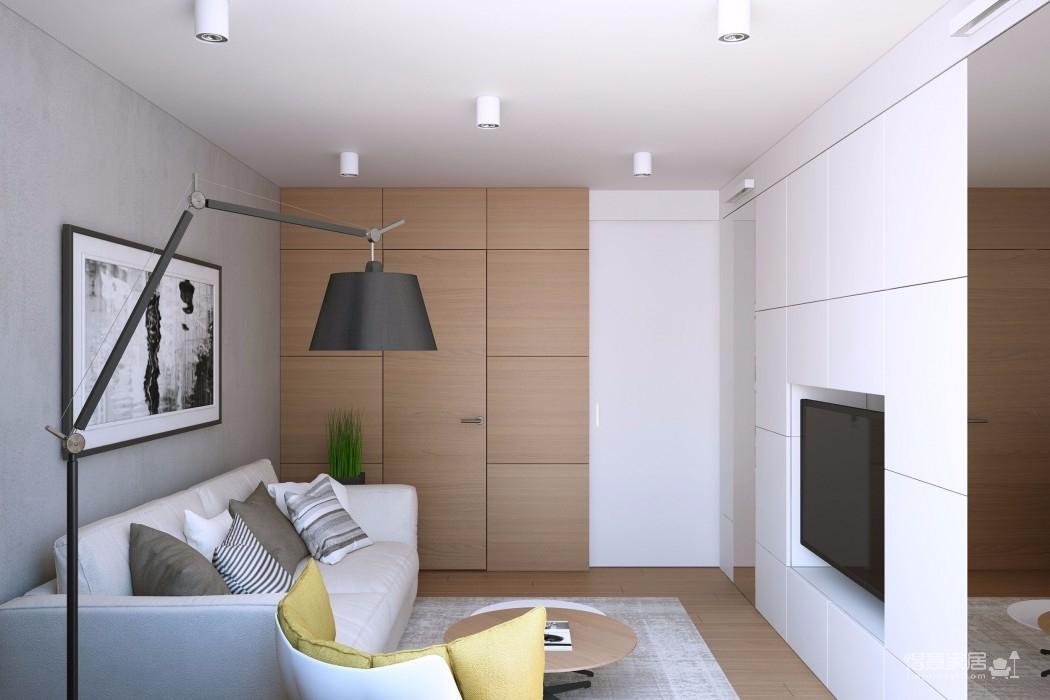 客厅蓝灰色乳胶漆墙面,搭配木色地板和茶几,灰色布艺沙发搭配背景墙上一组装饰画,整个空间简单又清新