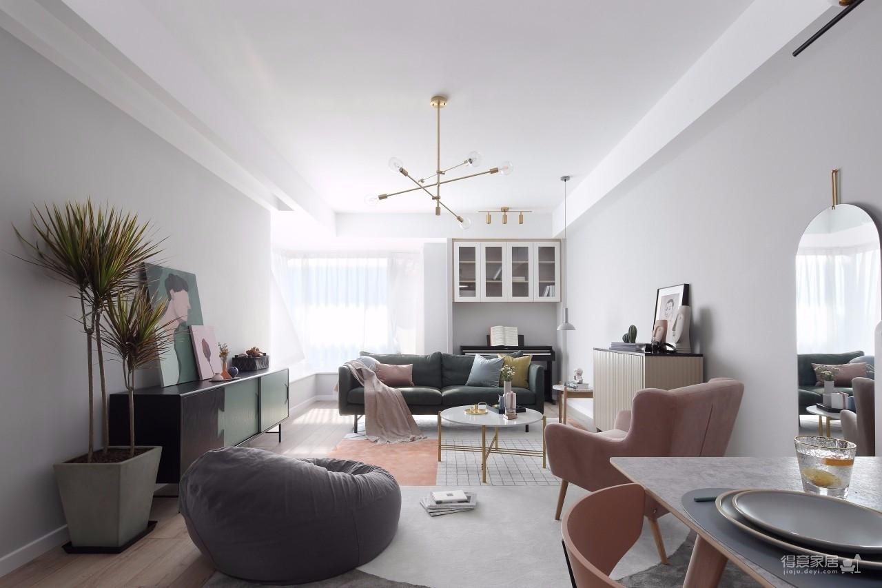 在明亮舒适的采光下,在现代简约灰的硬装基础色调下,通过粉色等温情优雅的软装布置,点缀出一个充满自然与舒适质感的居住氛围感。