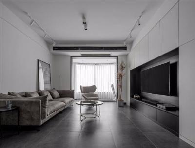 以黑白灰为主色调,在充分挖掘原户型厨房、客厅南北通透自然采光属性的前提下,去繁就简搭配低饱和度现代极简小体量家具,还原最原始的内建筑空间感。