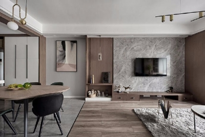 为避免素色空间带来的乏味感,以孔雀蓝绒布沙发点缀,搭配绿植与金属灯饰,将现代时尚融入生活。